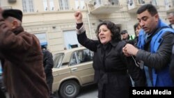 Azerbaijani opposition activist Gozal Bayramli insists that the banknotes were planted in her bag.