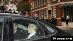 Julian Assange arrives at a London prison on December 7