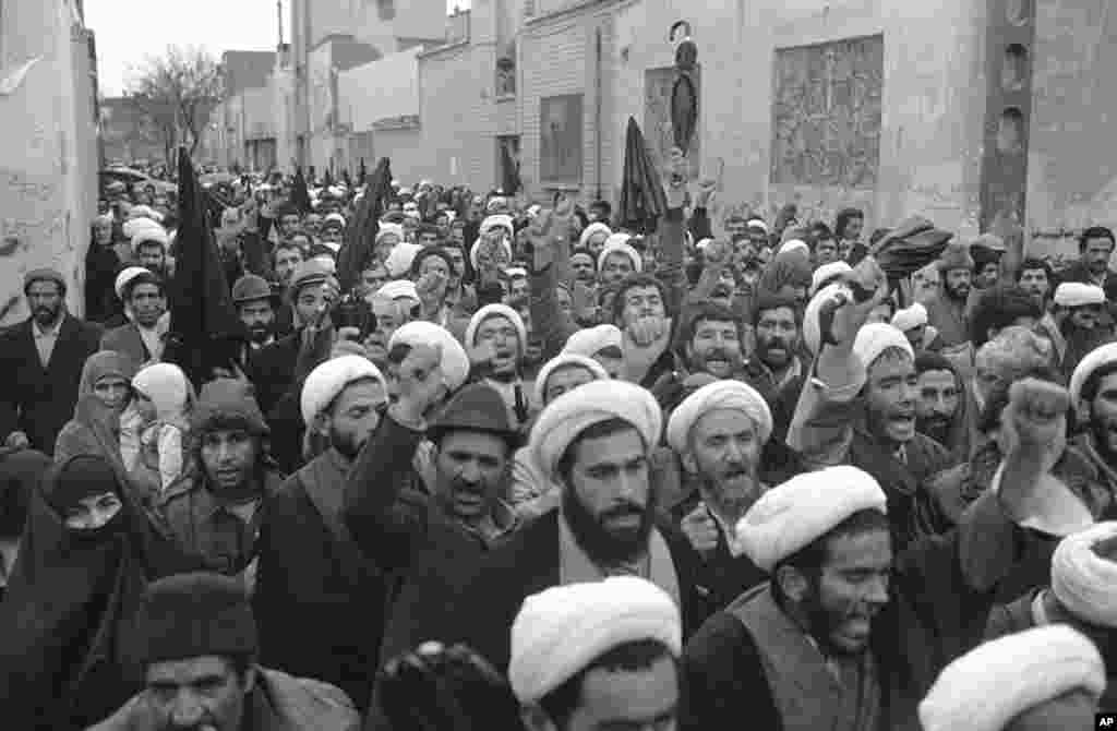 Mullahs march past Ayatollah Khomeini's house in Qom on December 17, 1979 in display of solidarity with the Iranian leader. Khomeini became Iran's Supreme Leader that month.