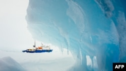 "This image taken by passenger Andrew Peacock of Footloosefotography.com on December 30 shows the ship ""MV Akademik Shokalskiy"" still stuck in the ice off East Antarctica, as it waits to be rescued."