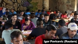 Migrants eat in a dorm in Bihac, Bosnia, on August 20.
