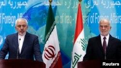 الجعفري وظريف في مؤتمر صحفي في بغداد 24 شباط 2015.