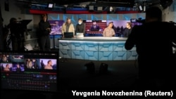 Journalists working in the studio of Radio Free Europe/Radio Liberty (RFE/RL) in Moscow