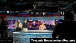 Journalists work in the studio of RFE/RL's Moscow bureau, April 6, 2021.