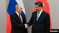 Президент России Владимир Путин и председатель КНР Си Цзиньпин.
