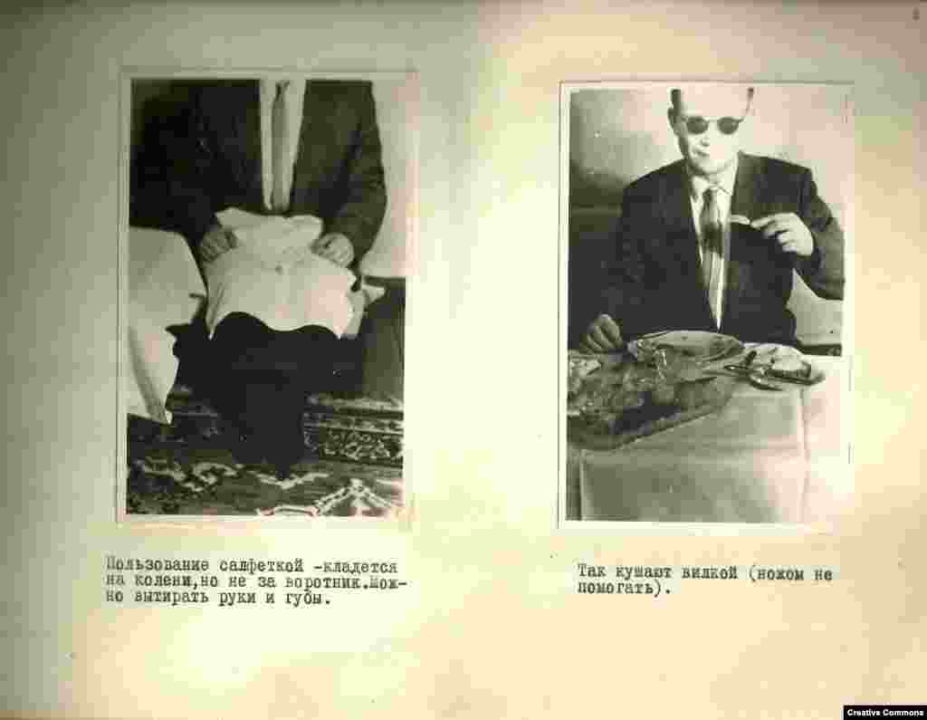 Use of a napkin -- place it on the knees, not in the collar. You can use it to wipe your hands and lips.   This is how they eat with a fork (do not assist yourself with a knife).