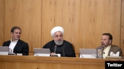 Iranian President Hassan Rouhani says Iran's enemies are taking advantage of the coronavirus outbreak in the country. Cabinet meeting, February 26, 2020.