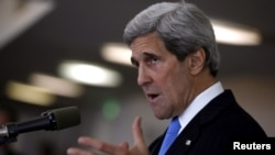 U.S. Secretary of State John Kerry speaks at a news conference in Tel Aviv on May 24.