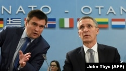 Ukranian Foreign Minister Pavlo Klimkin (left) and NATO Secretary-General Jens Stoltenberg at their meeting in Brussels on December 7.