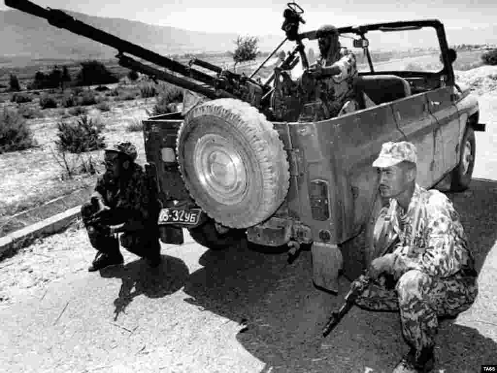 Tajik soldiers near Kabodien in August 1997 (TASS) - Much of the worst violence was directed against the Pamiri and Garmi ethnic minorities. Human Rights Watch described the efforts against them as an ethnic-cleansing campaign. It included mass killings, burnings of villages, and the driving of these populations into Afghanistan.