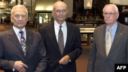 Apollo 11 crew members Buzz Aldrin (left), Michael Collins, and Neil Armstrong at the National Air and Space Museum in Washington on July 19.