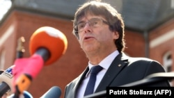 Carles Puigdemont speaks to the press in Neumuenster in April 2018.
