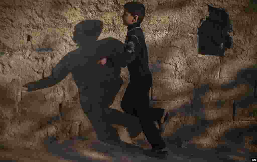 A Syrian boy plays on a street in the Teshreen neighborhood of Damascus. (epa/Mohammed Badra)