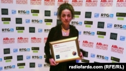 "Iranian Journalist Masih Alinejad, after receiving her AIB award for Radio Farda's production ""Victims of 88"" on Wednesday, London, November 6, 2013."
