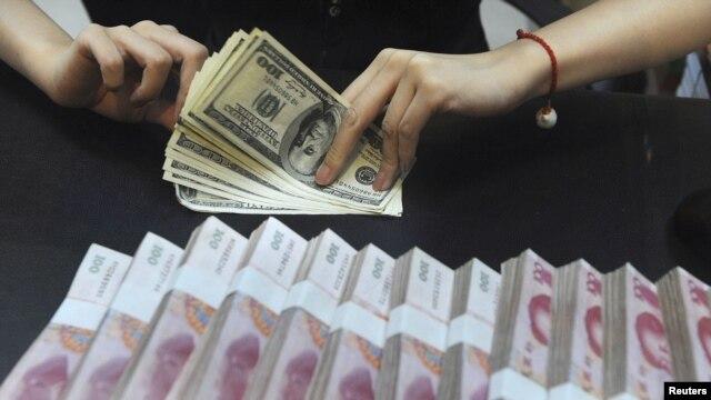 Kineski jeni i američki dolari