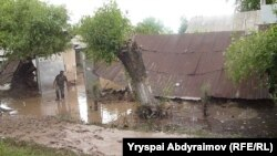Residents examine flood damage in the village of Abdraimov in the Jalal-Abad region on May 12.