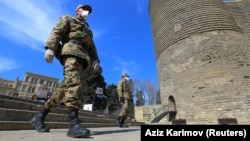 Azerbaijani servicemen patrol the streets of Baku amid a coronavirus lockdown.