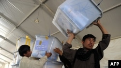 Afghan election workers move ballot boxes to the Independent Election Commission warehouse in Kabul on September 20.