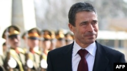 NATO Secretary-General Anders Fogh Rasmussen reviews an honor guard during a welcoming ceremony at the Presidential Palace in Kabul in December.