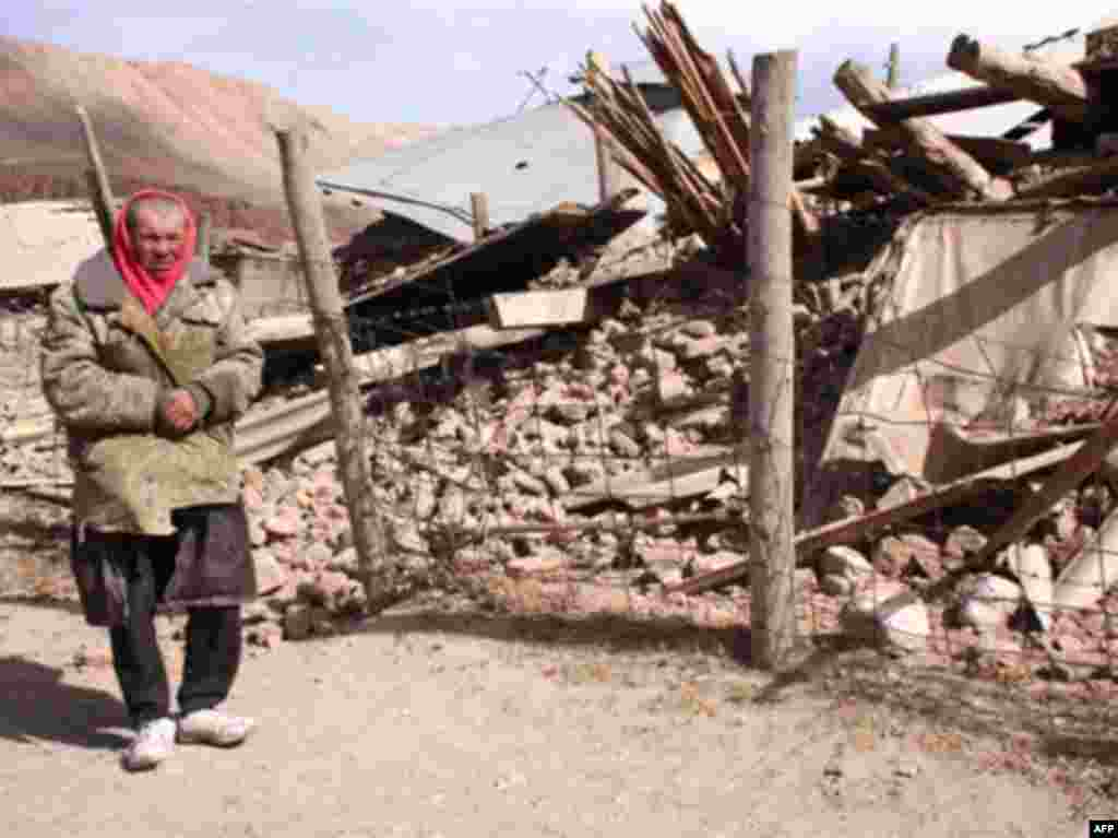 A man stands near a house in Nura destroyed by the 6.6-magnitude earthquake. - KYRGYZSTAN, NURA : A Kyrgyz man stands near a destroyed house at the site of a major earthquake in Nura on October 6, 2008. Rescuers raced to reach a remote village in Kyrgyzstan on Monday after a strong earthquake killed at least 72 people in a mountainous area near the border with China, officials said. The quake late Sunday, which measured magnitude 6.6 according to the US Geological Survey (USGS), razed the village of Nura in the isolated Alaisky district, high in the Tian Shan mountain range