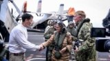 Министерката за одбрана Радмила Шекеринска објави дека на авионите на американскиот носач на авиони Хари С. Труман било аплицирано македонското знаме