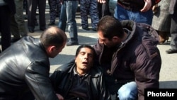 Ten people were killed and scores injured in the March violence.