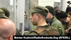 Юлія Кузьменко у скляному боксі в суді 20 грудня 2019 року