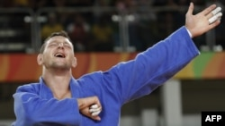The Czech Republic's Lukas Krpalek celebrates after defeating Azerbaijan's Elmar Gasimov during their men's 100 kilogram gold medal match in judo at the 2016 Olympic Games in Rio de Janeiro on August 11.