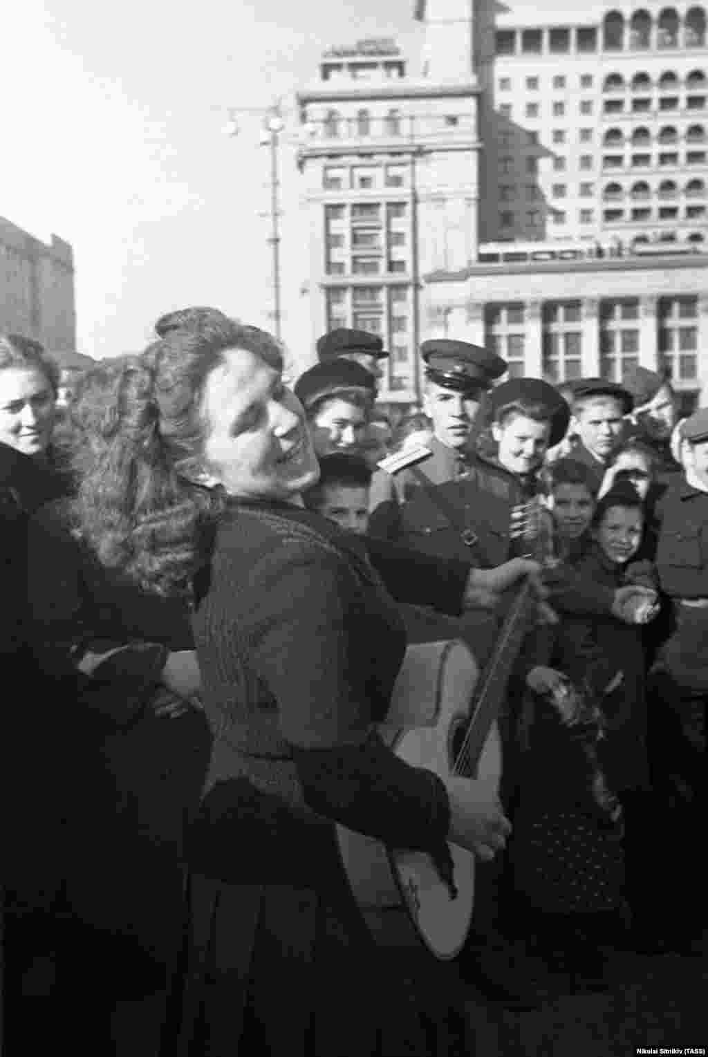 A woman breaks into song in central Moscow. In the Soviet Union, the party got started in earnest on May 9.