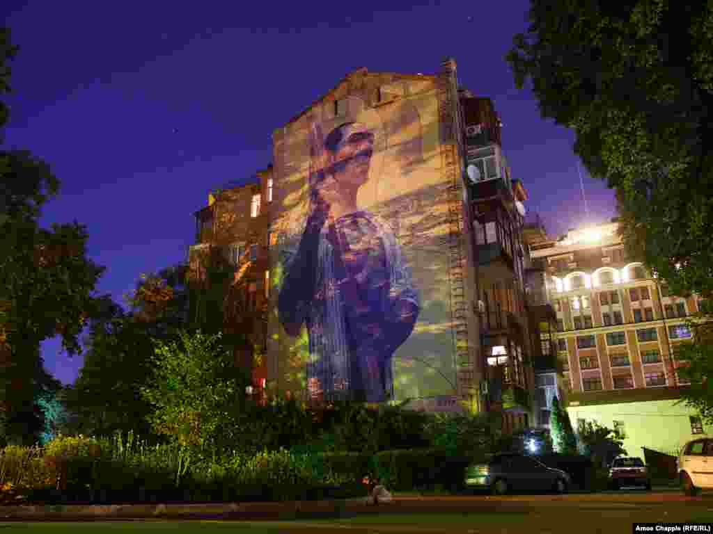 A mural by Spanish artist Aryz inside a courtyard in central Kyiv. Since its inception in 2015, when there were just a handful of such works, the interactive map now locates 137 murals in the Ukrainian capital.