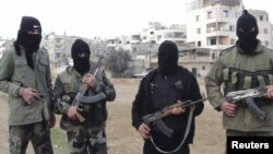 Syria -- Army defectors pose for a photograph in Duma, 25Jan2012