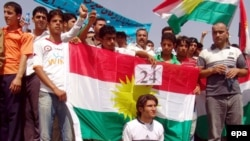 Iraqi Kurdish demonstrators in Irbil protest the passage of a bill delaying the census in the disputed region of Kirkuk.