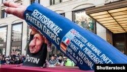 Фигура, изображающая Владимира Путина и его союзников из числа европейских крайне правых, на карнавале в Дюссельдорфе (Германия), 2016 год