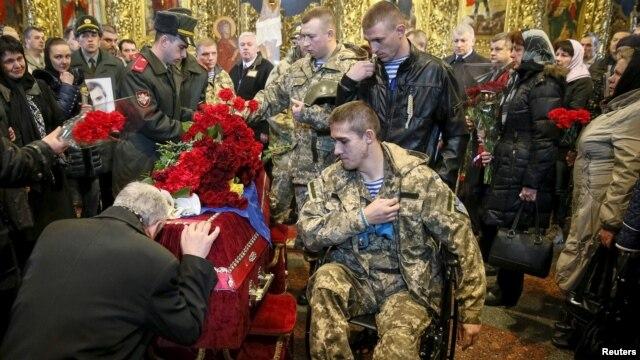 Похороны украинского военнослужащего Игоря Брановицкого, убитого на востоке Украины. Киев, 3 апреля 2015 года.