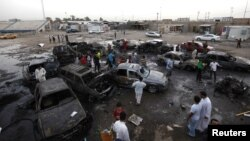 Residents gather at the site of a car bomb attack in Baghdad's Sadr City on May 27.