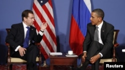 France -- US President Barack Obama (R) and his Russian counterpart Dmitry Medvedev speak during the G8 Summit in Deauville, 26May2011