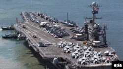 "The U.S. nuclear-powered aircraft carrier ""USS George Washington"""