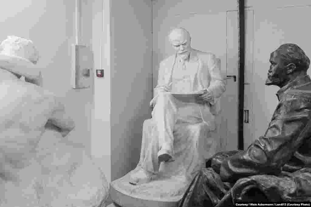 Two Lenin statues sit in storage at the National Art Museum in Kyiv.