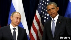 Russian President Vladimir Putin (left) meets with his U.S, counterpart Barack Obama at the UN in New York on September 28.