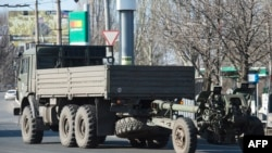 "An artillery gun of the self-proclaimed ""People's Republic of Donetsk"" is towed in Donetsk in March."