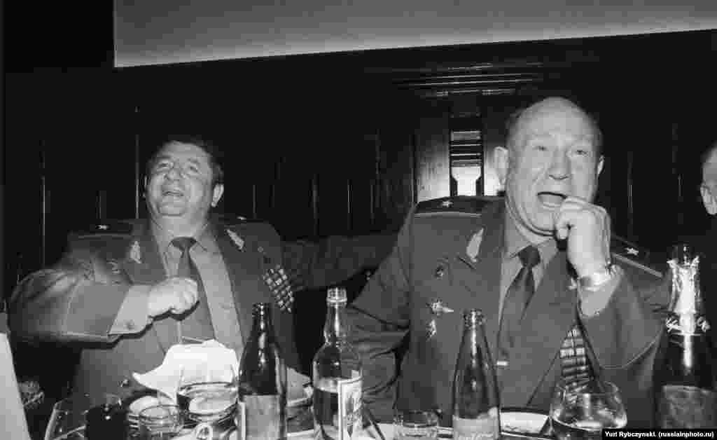 Soviet cosmonauts Pyotr Klimuk (left) and Aleksei Leonov partying in the early 1990s. Klimuk was the first Belarusian in space. Leonov was the first man to carry out a spacewalk when, in March, 1965, he floated through space attached to his spacecraft with a rope tether.
