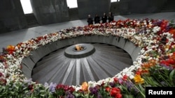 People mourn at the Tsitsernakaberd Armenian Genocide Memorial Museum in Yerevan on April 21.