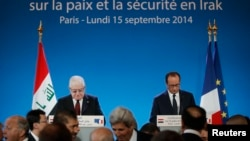 France -- French President Francois Hollande (R) and Iraqi President Fuad Masum attend the opening of an international conference on fight against Islamic State in Paris, September 15, 2014