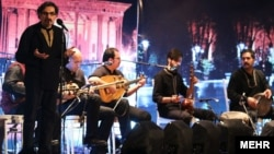 Ahmad Mehrchian and his wife, Zohreh Barati, decided to launch their protest after a concert by the veteran traditional musician Shahrem Nazeri (far left) and his son was canceled by authorities at short notice.