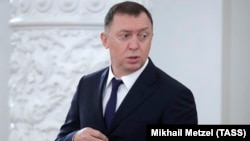 Russian tycoon Oleg Deripaska attends a meeting with Russian President Vladimir Putin and South Korea's president in June.