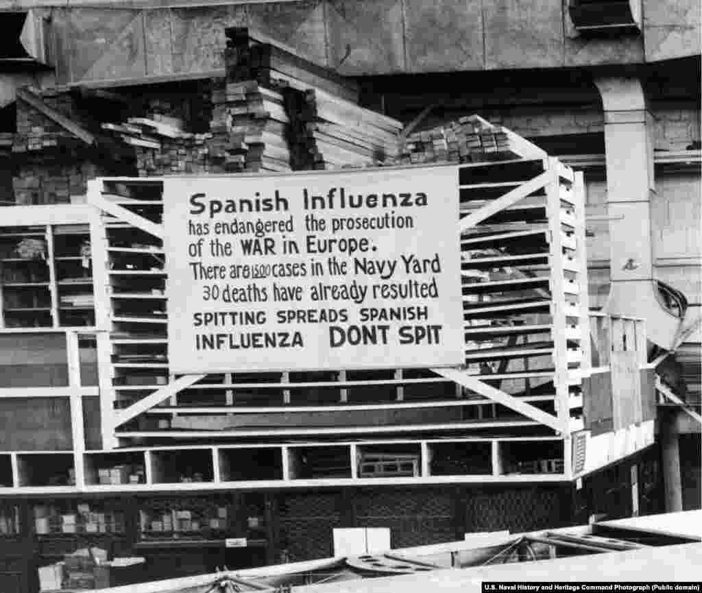 A sign warning workers not to spit at Philadelphia's Naval Aircraft Factory on October 19, 1918. Philadelphia turned out to be one of the hardest-hit cities in the United States by the Spanish flu pandemic after officials failed to move early to cancel mass gatherings, like the Liberty Loan Parade.