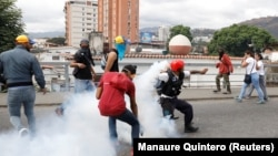 На акции протеста против Николаса Мадуро в Каракасе. 23 января 2019 года.