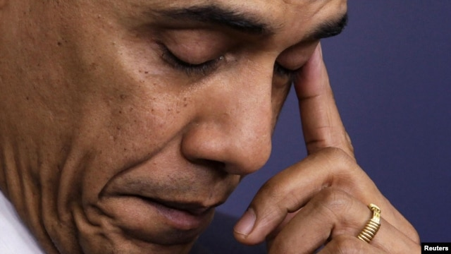 U.S. President Barack Obama wipes a tear as he speaks about the shooting at Sandy Hook Elementary School.