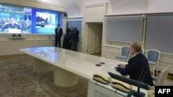 Russian President Vladimir Putin watches a live broadcast of the launch from the Plesetsk cosmodrome in a presidential situation center in Moscow on December 23.