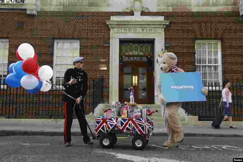 A look-alike of Britain's Prince Harry takes part in a publicity stunt in front of the Lindo Wing of St. Mary's Hospital, where Kate, officially known as the Duchess of Cambridge, is in labor.